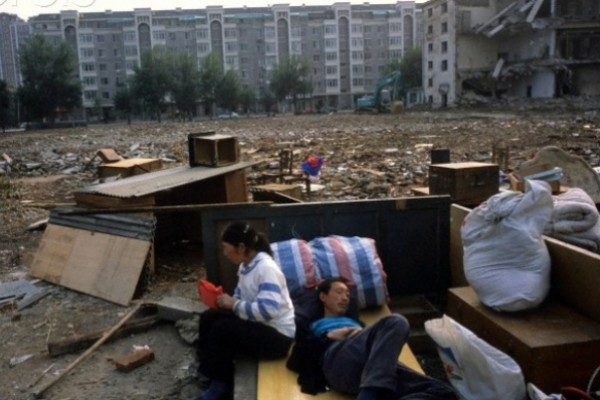 China cuts poor population by two-thirds